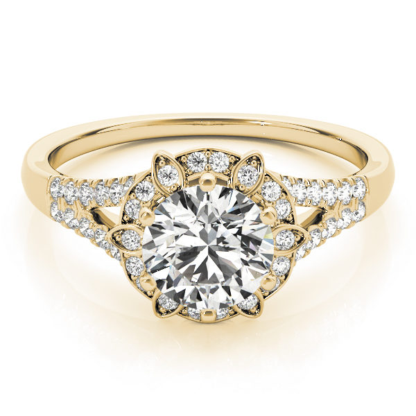 top view of a petite yellow gold diamond halo engagement ring surrounded by smaller diamonds on each of the split shanks