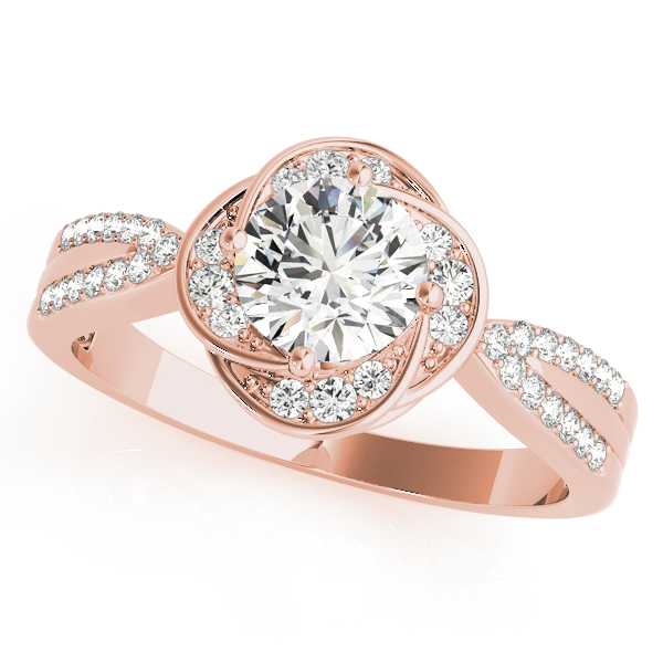 Top view of a rose gold halo engagement ring with accent stones on its halo and split band