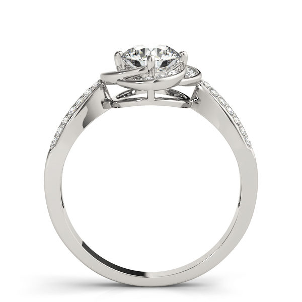Side view of a silver halo engagement ring with a flat cathedral band embedded with accent stones