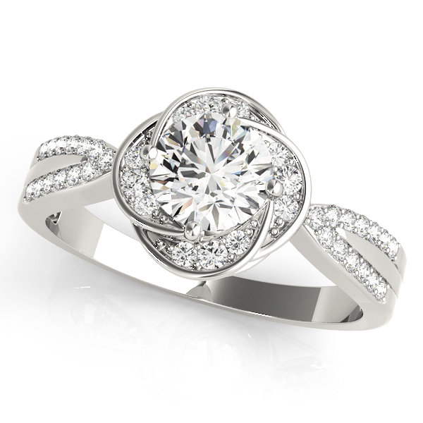 Top view of a silver halo engagement ring with accent stones on its halo and split band