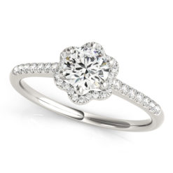 top view of a petite white gold diamond halo engagement ring gripped by 6 white gold prongs surrounded by smaller diamonds on each side of the shoulder