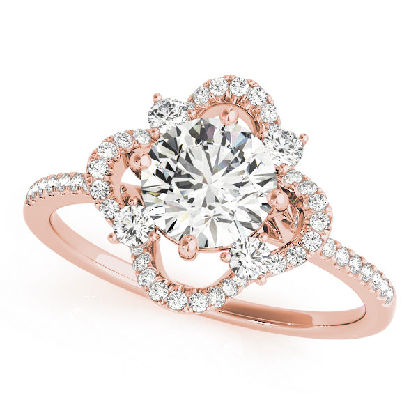 Top eye view of a rose gold halo engagement ring with a diamond center stone, four side stones and accent stones on its band