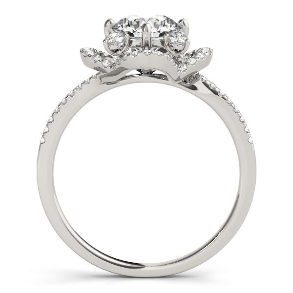 Side view of a silver halo engagement ring with accent stones on its band and halo