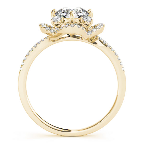 Side view of a white gold halo engagement ring with accent stones on its band and halo