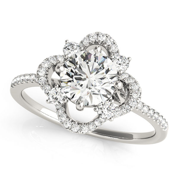 Top view of a silver halo engagement ring with a diamond center stone, four side stones and accent stones on its band