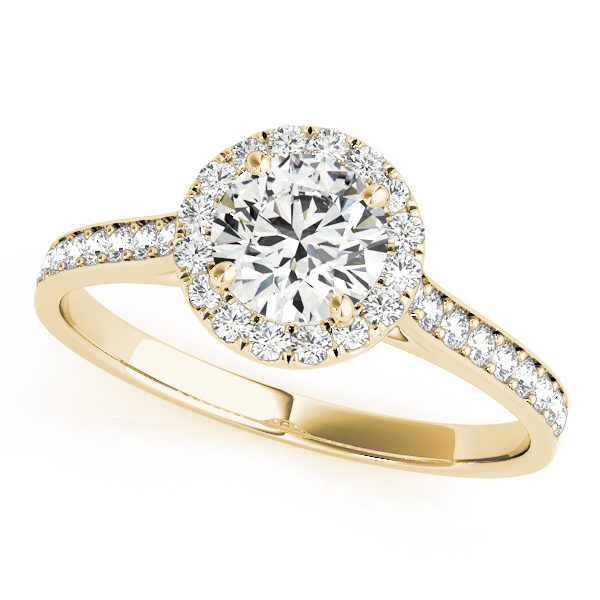 top view of a petite yellow gold halo engagement ring with a round diamond gripped by 4 prongs surrounded in smaller diamonds