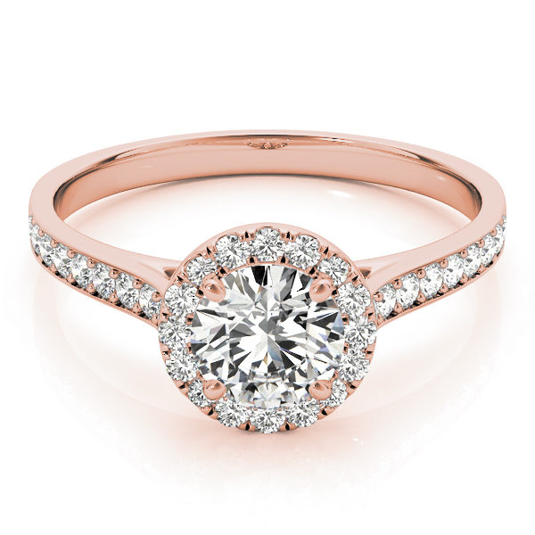 Top view of a rose-gold halo engagement ring with a large diamond on top with small diamonds surrounding it and also along the band