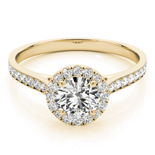 Top view of a yellow-gold halo engagement ring with a large diamond on top with small diamonds surrounding it and also along the band