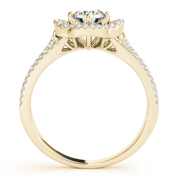 Front view of a pave halo engagement ring with diamond stones in upper shank in yellow gold