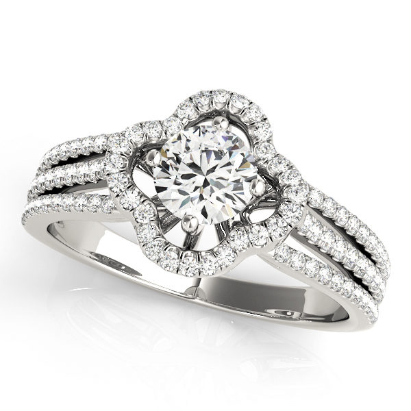 Top view of a white gold clover shaped pave halo engagement ring in three row bands with set of smaller diamonds