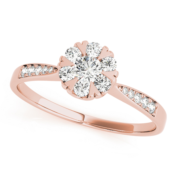 Top view of rose gold round cut diamond ring with heart shaped prongs and intricate design on band