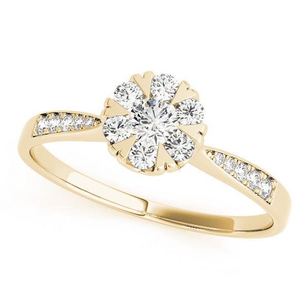 Top view of yellow gold round cut diamond ring with heart shaped prongs and intricate design on band