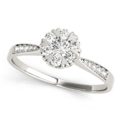 White gold diamond with heart shape prongs and channel set of diamonds on upper shank