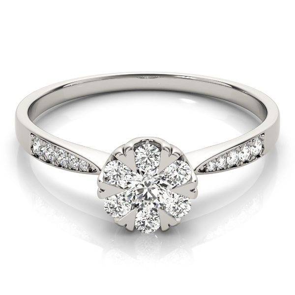 A laying front view of white gold round cut diamond ring held by heart shaped prongs and channel set of diamond on upper shank