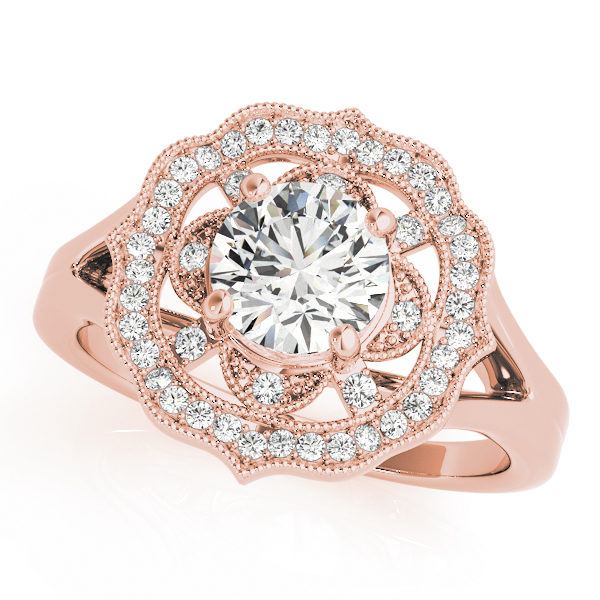 Top view of a rose gold halo engagement ring with accent stones on its halo