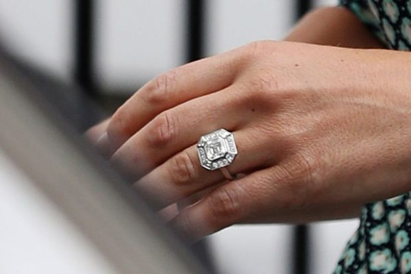 A focus of Pippa Middleton's hand displaying her Asscher cut diamond white gold engagement rings