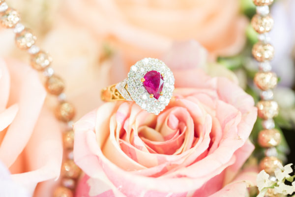 Tear drop shaped pink sapphire engagement rings in set of pave of diamonds