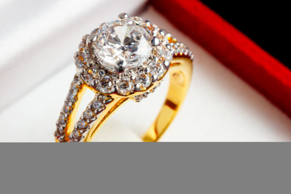 Split shank diamond engagement ring care surrounded by small diamonds
