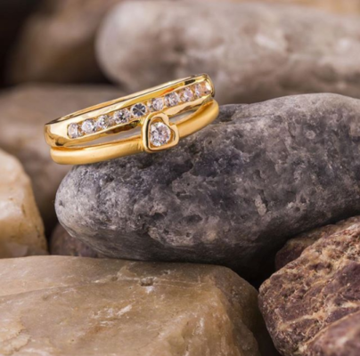 Yellow gold split shank diamond engagement band with small diamond placed in stones