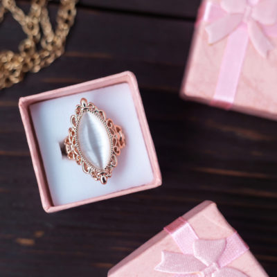 Sample of vintage engagement rings, a marquise cut placed in a pink ring box