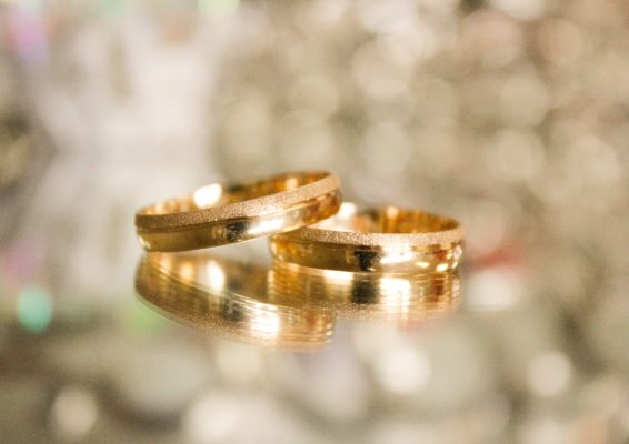 Close up view of wedding rings leaning on each other