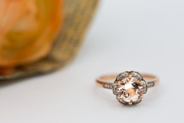 a morganite engagement ring held by 6 prong and rose gold metal